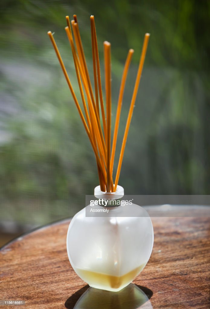 Sticks of incense in glass jar : Stock Photo