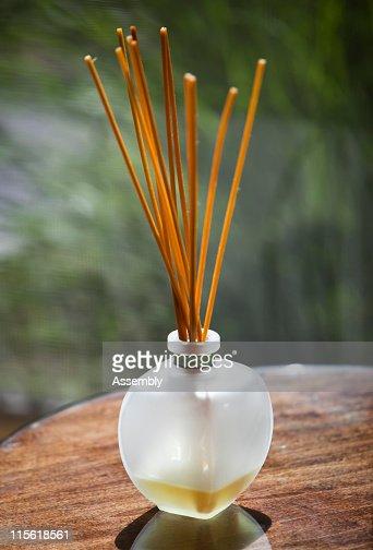 Sticks of incense in glass jar : Stockfoto