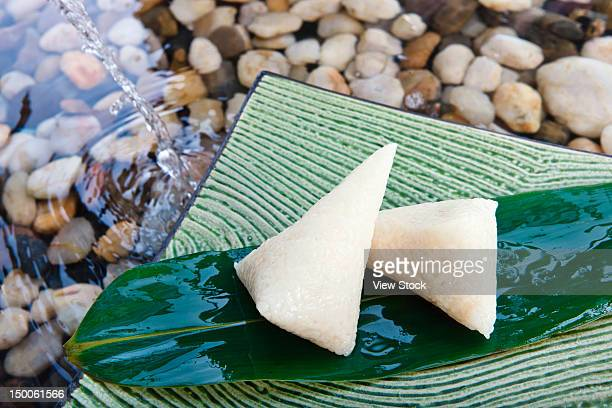 'Sticky rice dumplings wrapped in leaves,close up'