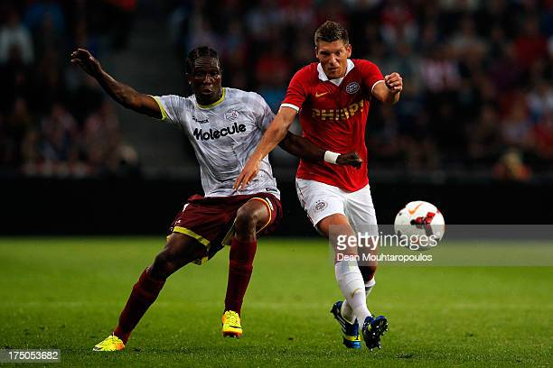 Stijn Schaars of PSV and Habib Habibou of Zulte Waregem battle for the ball during the First Leg 3rd Qualifying Round UEFA Champions League match...
