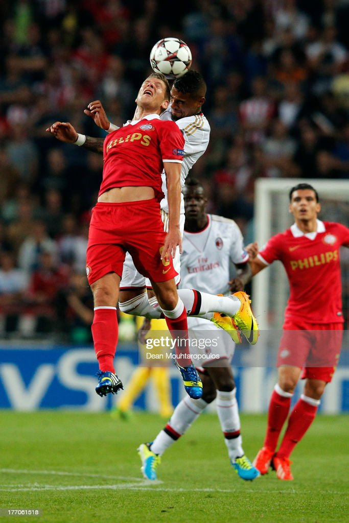 Stijn Schaars of PSV and Kevin-Prince Boateng of AC Milan battle for the header during the UEFA Champions League Play-off First Leg match between PSV Eindhoven and AC Milan at PSV Stadion on August 20, 2013 in Eindhoven, Netherlands.