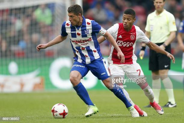 Stijn Schaars of sc Heerenveen David Neres of Ajax referee Danny Makkelieduring the Dutch Eredivisie match between Ajax Amsterdam and sc Heerenveen...