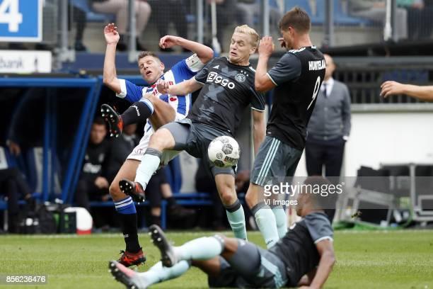 Stijn Schaars of sc Heerenveen Donny van de Beek of Ajax Klaas Jan Huntelaar of Ajax David Neres of Ajax during the Dutch Eredivisie match between sc...