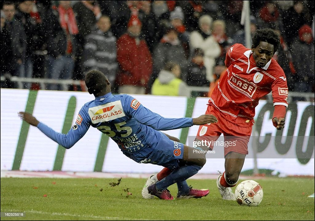 Stijn Wertelaers of KRC Genk and Antonio Pereira Dos Santos Kanu of Standard Liege in action during the Jupiler League match between Standard de Liege and KRC Genk on February 24, 2013 in Liege, Belgium.