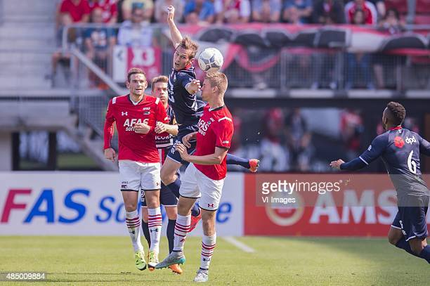 Stijn Wuytens of Willem II Markus Henriksen of AZ Alkmaar during the Dutch Eredivisie match between AZ Alkmaar and Willem II Tilburg at AFAS stadium...