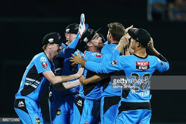 Stikers players celebrate after Ben Laughlin of the Adelaide Strikers got the wicket of Johan Botha of the Sydney Sixers during the Big Bash League...