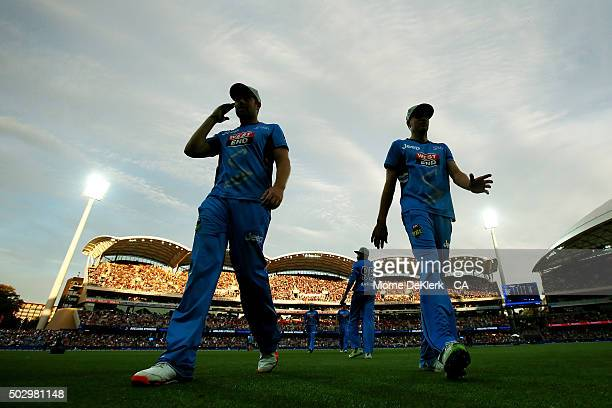 Stikers players come from the field at the innings break during the Big Bash League match between the Adelaide Strikers and the Sydney Sixers at...