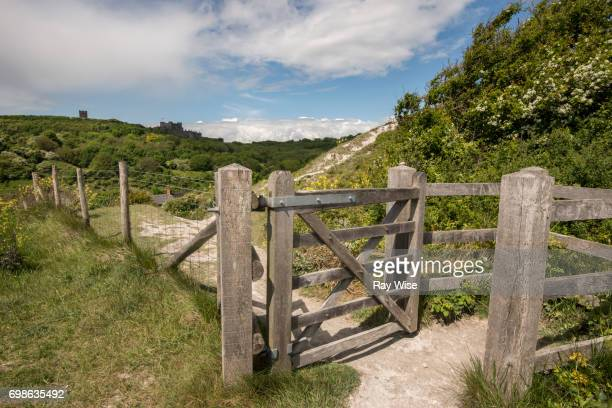 Stile and gate on White Cliffs Trail with Dover Castle in background