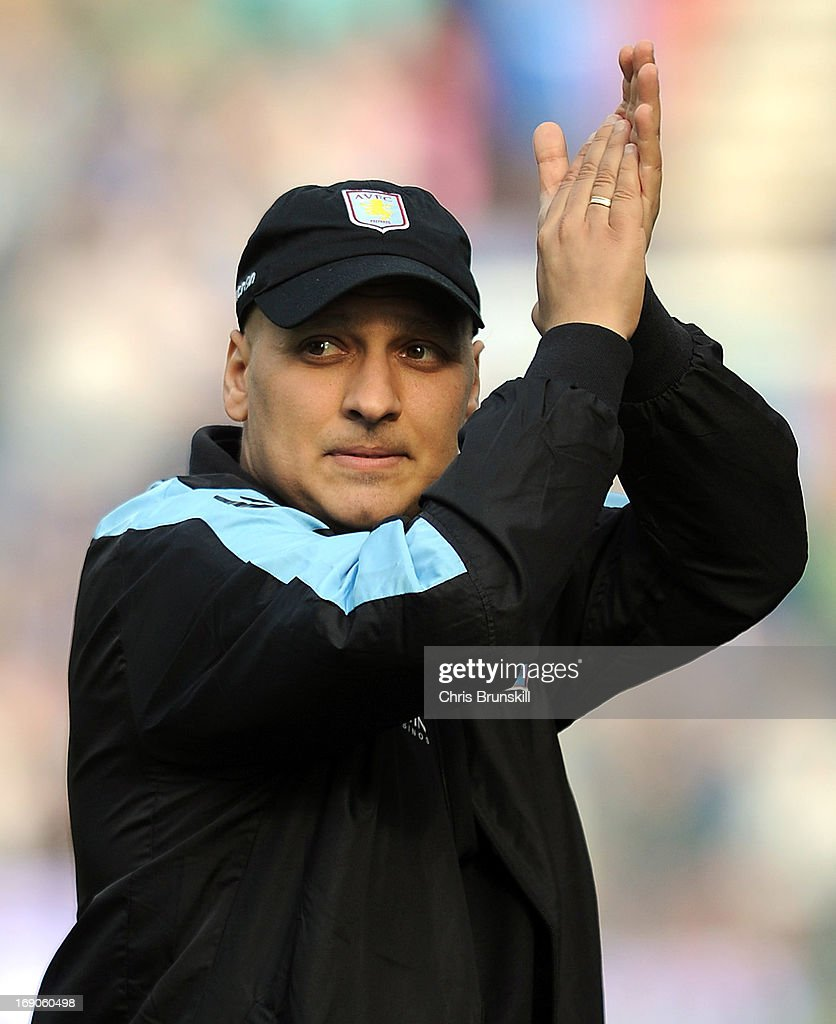 Stiliyan Petrov of Aston Villa applauds the supporters following the Barclays Premier League match between Wigan Athletic and Aston Villa at DW Stadium on May 19, 2013 in Wigan, England.