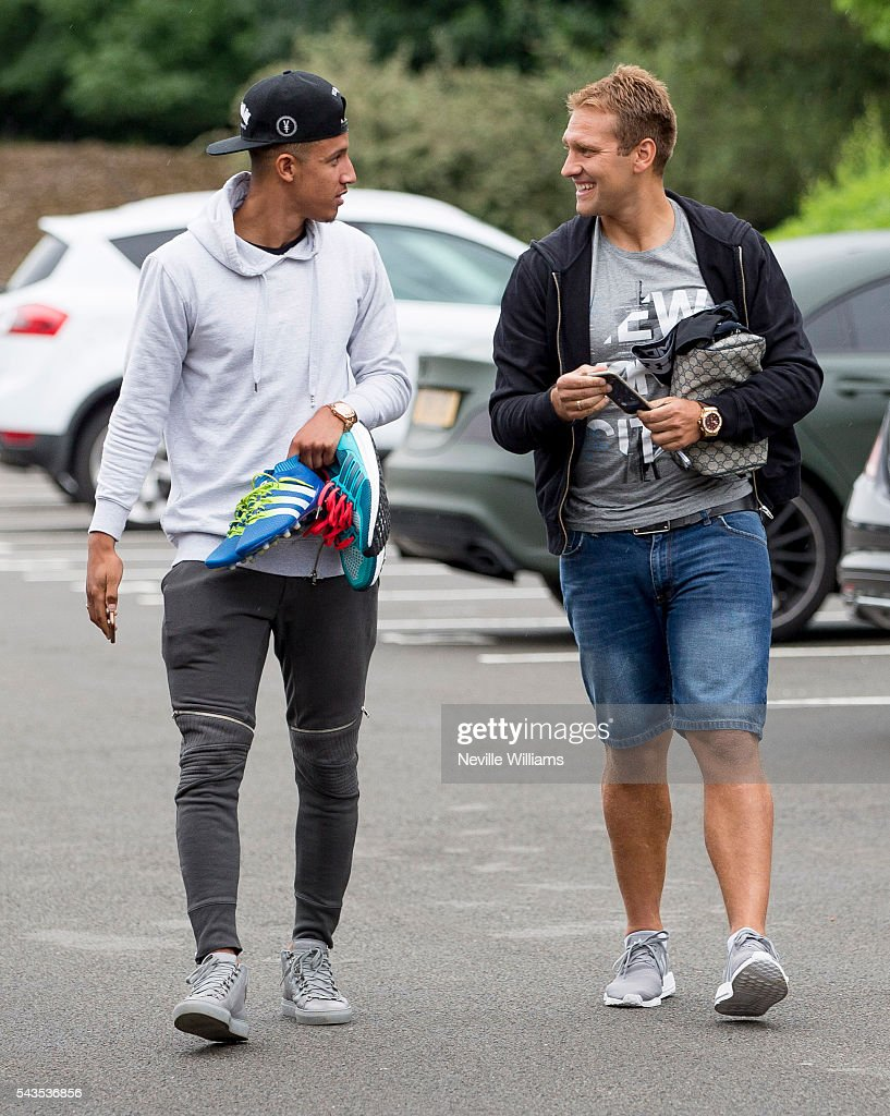 Stiliyan Petrov of Aston Villa arrives for training with team mate Callum Robinson at Aston Villa's training ground at Bodymoor Heath on June 29, 2016 in Birmingham, England.