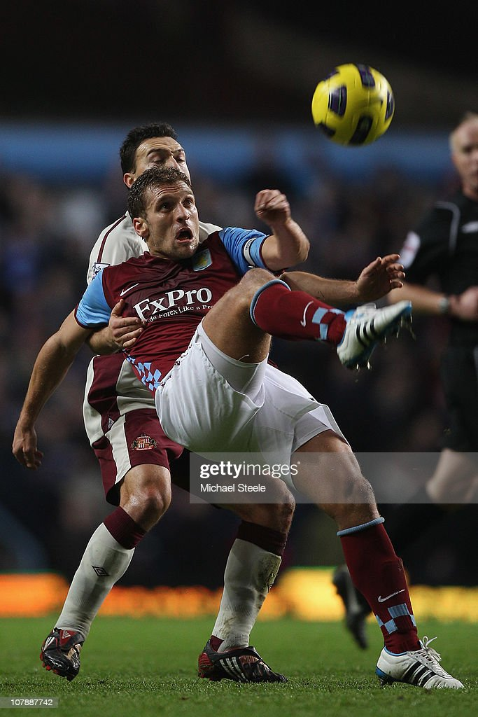 Stiliyan Petrov of Aston Villa clears from <a gi-track='captionPersonalityLinkClicked' href=/galleries/search?phrase=Steed+Malbranque&family=editorial&specificpeople=206647 ng-click='$event.stopPropagation()'>Steed Malbranque</a> of Sunderland during the Barclays Premier League match between Aston Villa and Sunderland at Villa Park on January 5, 2011 in Birmingham, England.