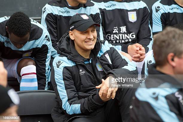 Stiliyan Petrov of Aston Villa takes a seat on the bench before the Barclays Premier League match between Wigan Athletic and Aston Villa at DW...