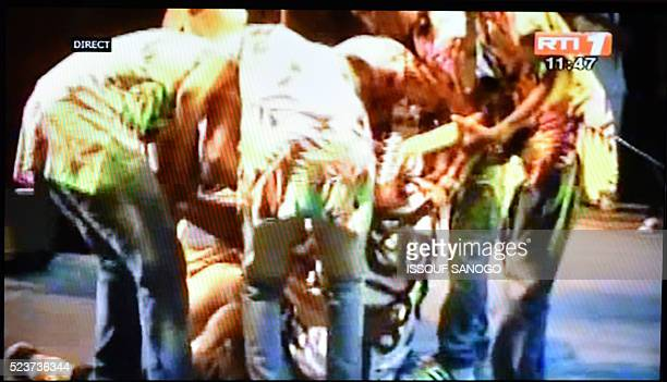 A still frame taken from Ivory Coast national television RTI 1 on April 24 2016 shows Congolese music star Papa Wemba collapsing on stage during the...