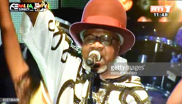 A still frame taken from Ivory Coast national television RTI 1 on April 24 2016 shows Congolese music star Papa Wemba performing during the FEMUA...