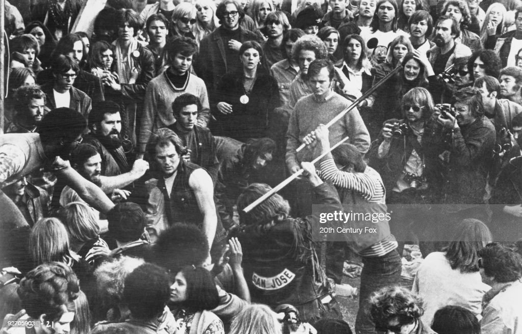 A still from the documentary film 'Gimme Shelter', showing audience members looking on as Hells Angels beat a fan with pool cues at the Altamont Free Concert, Altamont Speedway, California, 6th December 1969. The concert was headlined and organized by The Rolling Stones. The film was directed by Albert Maysles, David Maysles and Charlotte Zwerin.