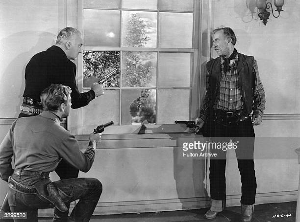 A still from 'The Marauders' directed by George Archainbaud for United Artists From left to right actors Rand Brooks William Boyd and Andy Clyde...