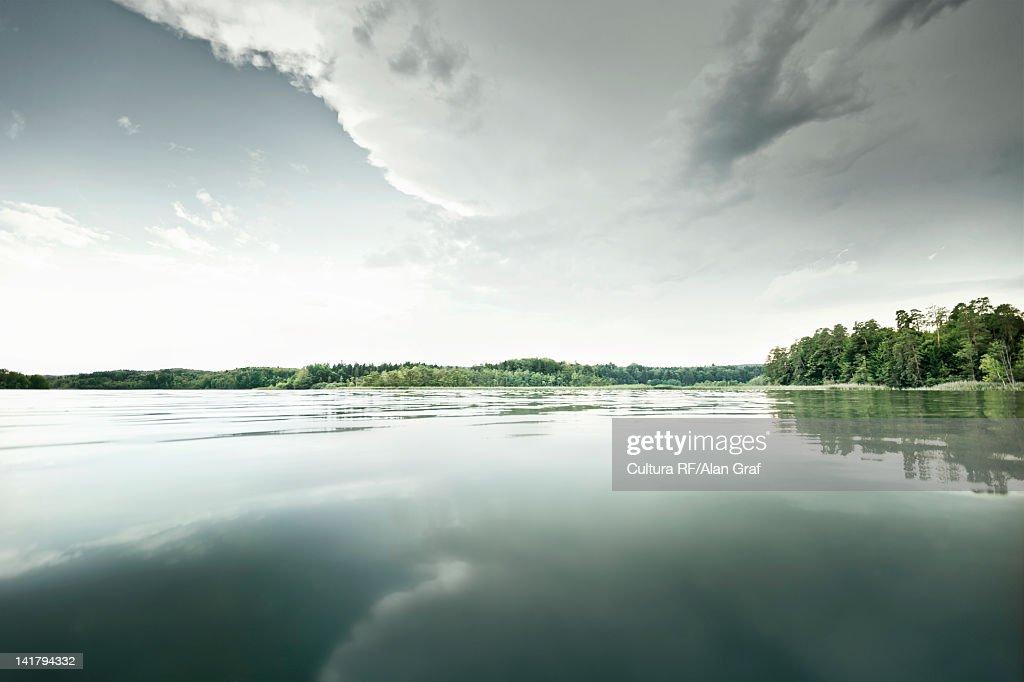 Still lake in rural landscape