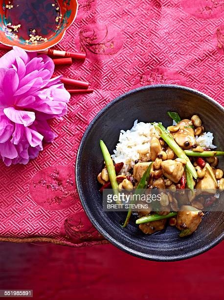 Still life bowl of stir fry Kung Pao Chicken with vegetable and peanuts