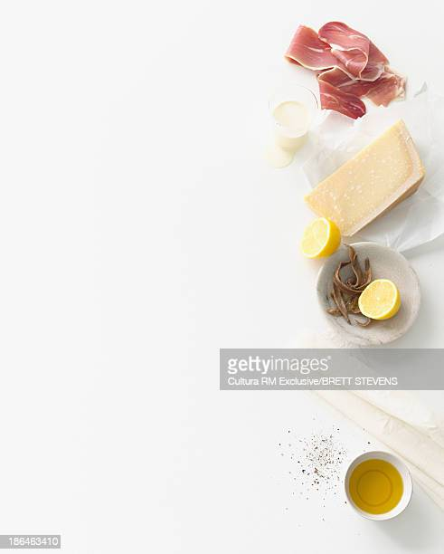 Still life food selection of parma ham, parmesan and anchovies