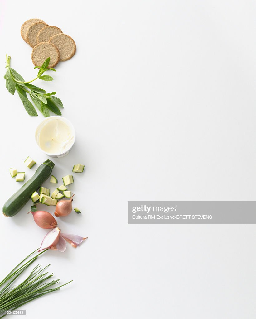 Still life food selection of zucchini, cream and digestive biscuits : Stock Photo