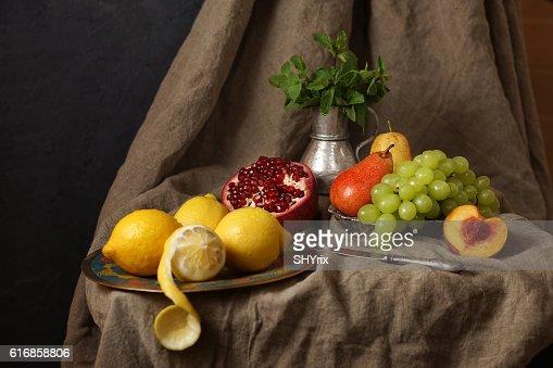 Still life in the Studio, pomegranate, grape, lemon. : Stock Photo