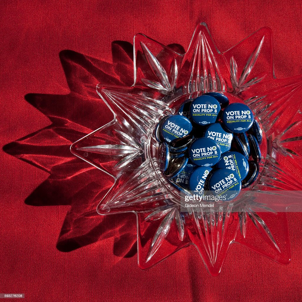 Still life of a crystal ashtray filled with buttons from the 'No on Prop 8 ' campaign in the home of Patricia Davenport and Evelyn Marquez together...