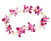 Still life of a flower lei on a white background.