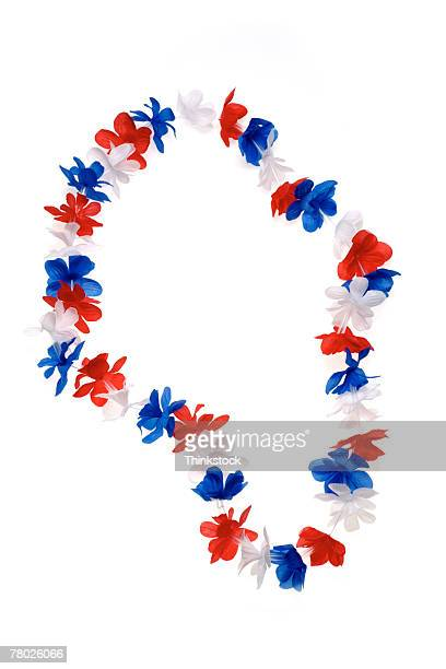 Still life of a patriotic, red, white, and blue lei.