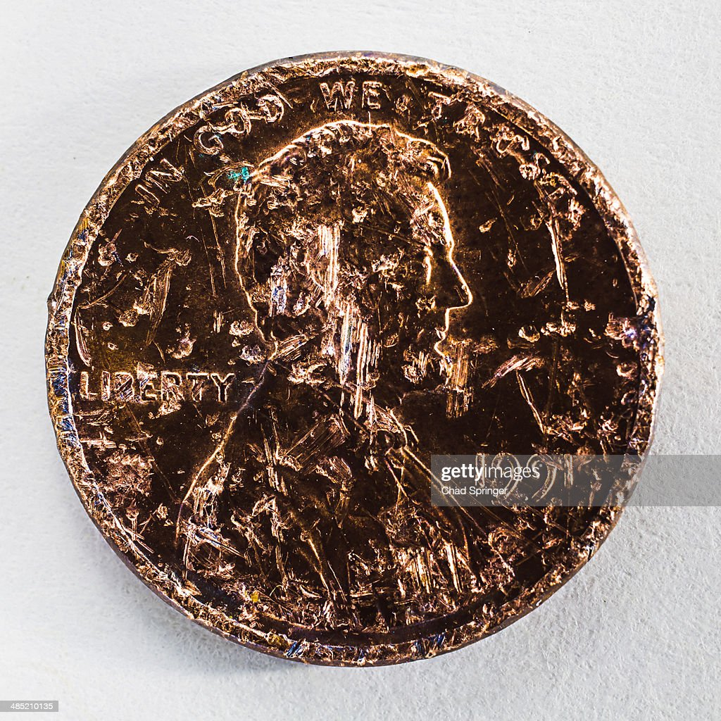 Still life of a scratched one cent coin : Stock Photo