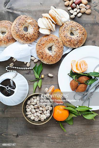 Still life of bagels and flatbreads with fruit and nuts