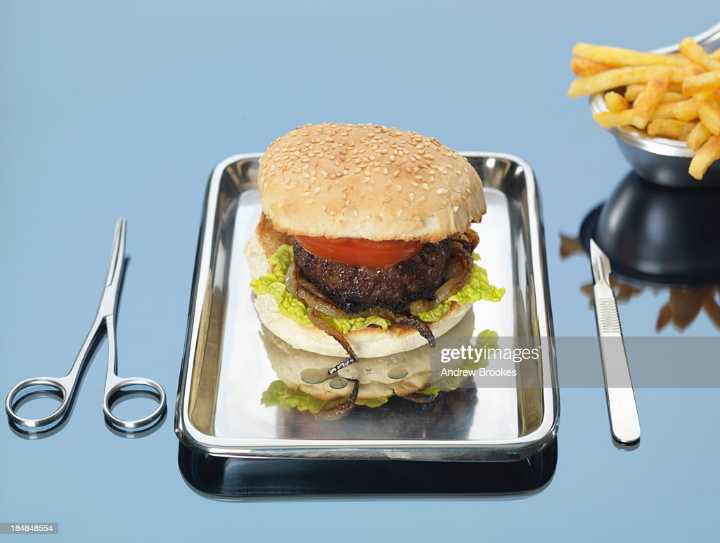 Still life of beef burger on surgical tray