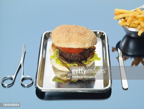 Still life of beef burger on surgical tray : Stock Photo