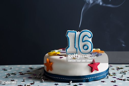 Still Life Of Birthday Cake With Number 16 Candle Stock