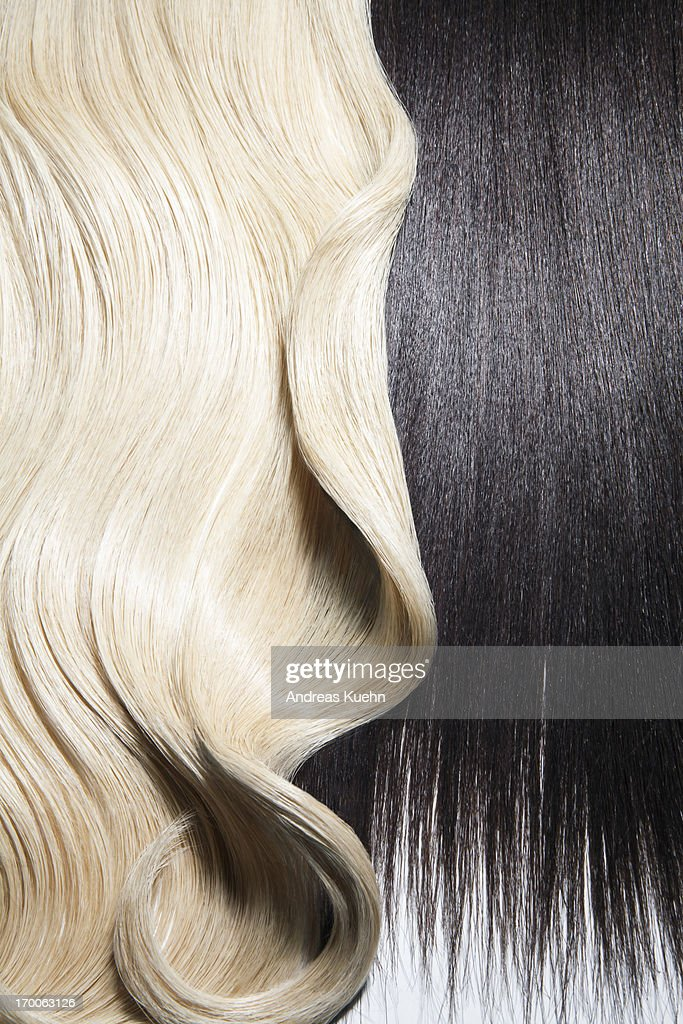 Still life of blond and dark brown hair. : Stock Photo