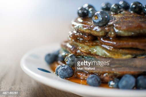 Still life of blueberry pancakes with maple syrup : Stock Photo