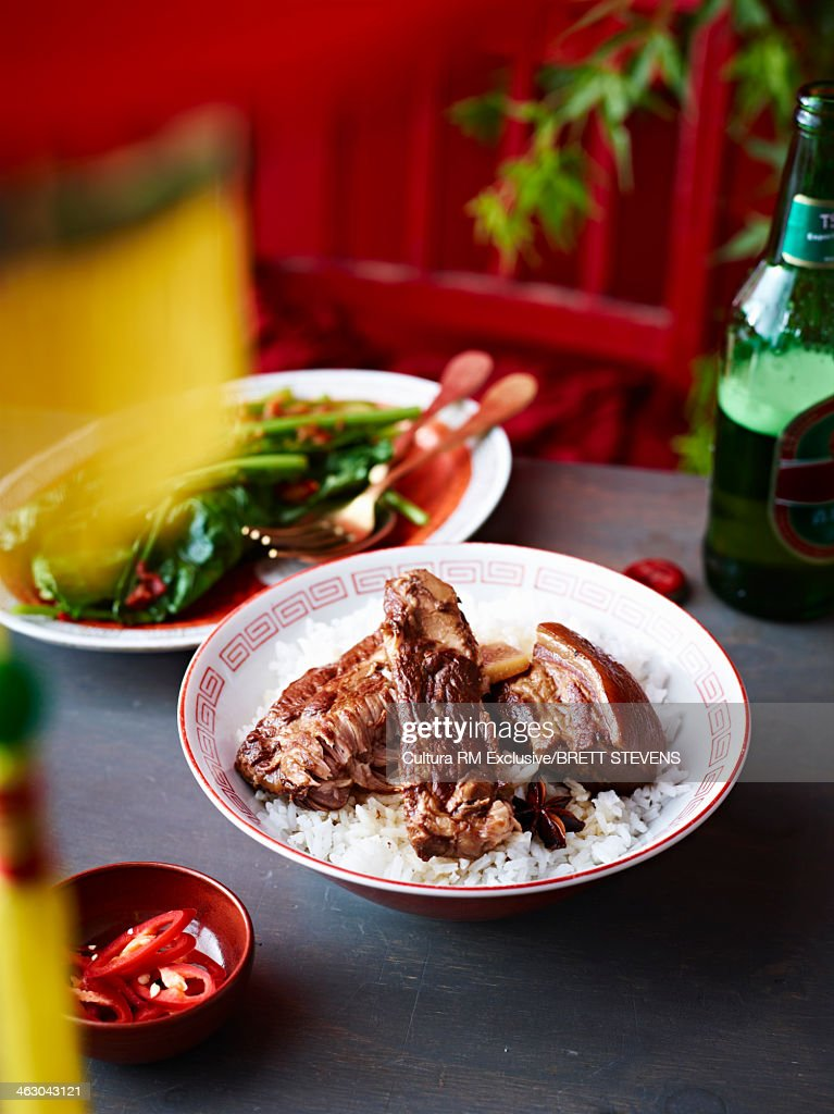 Still life of braised vinegar pork belly with spring greens : Stock Photo