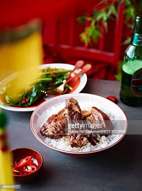 Still life of braised vinegar pork belly with spring greens