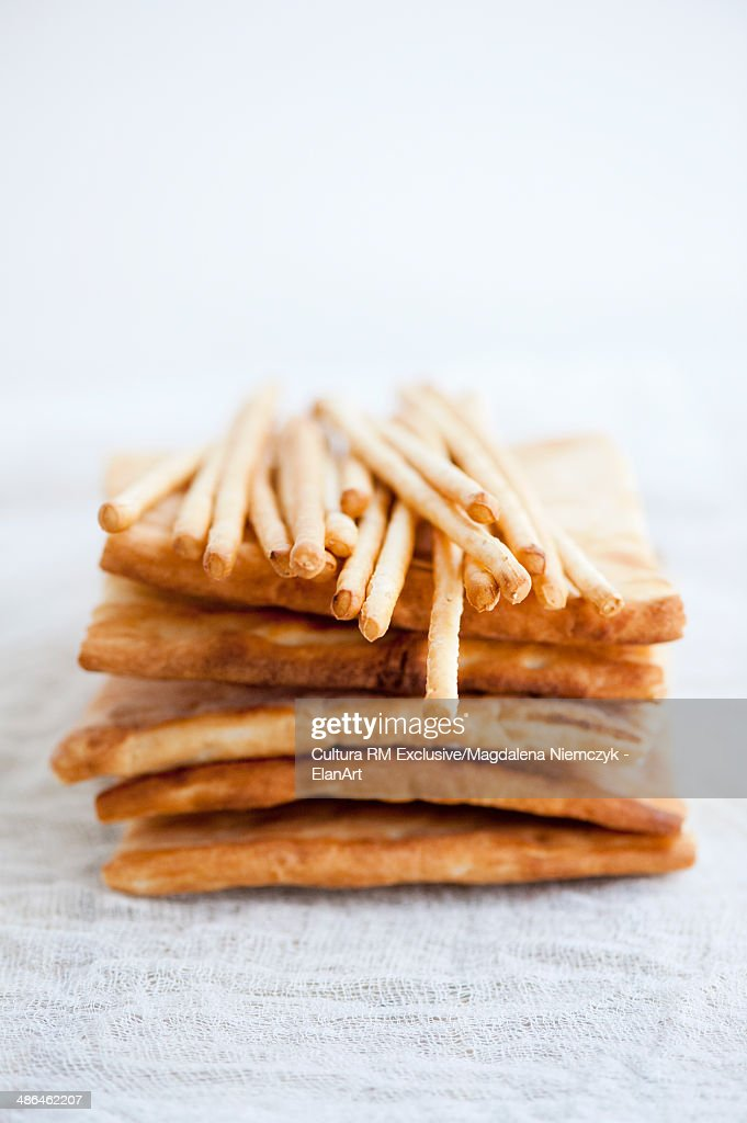 Still life of bread sticks on top of flatbread stack : Stock Photo