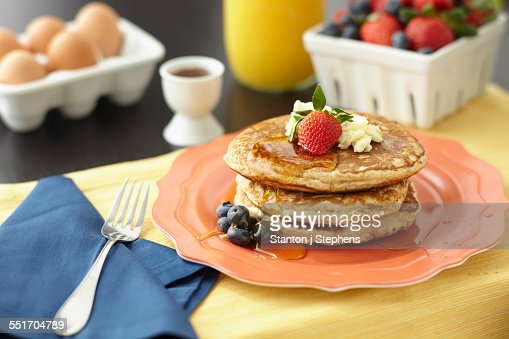 Still life of breakfast pancakes with fruit