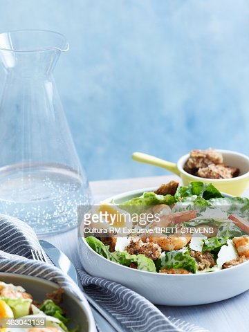 Still life of caesar salad with prawns and croutons : Stock Photo