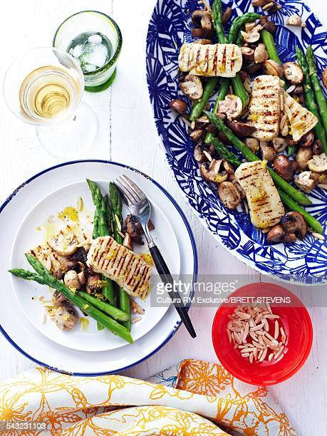 Still life of char grilled haloumi with mushrooms and asparagus