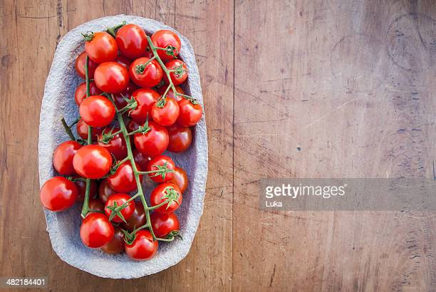 Still life of cherry vine tomatoes in cardboard container