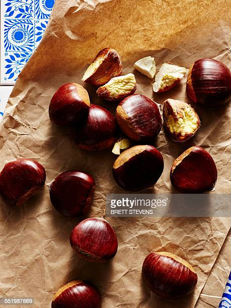 Still life of chestnuts on brown paper