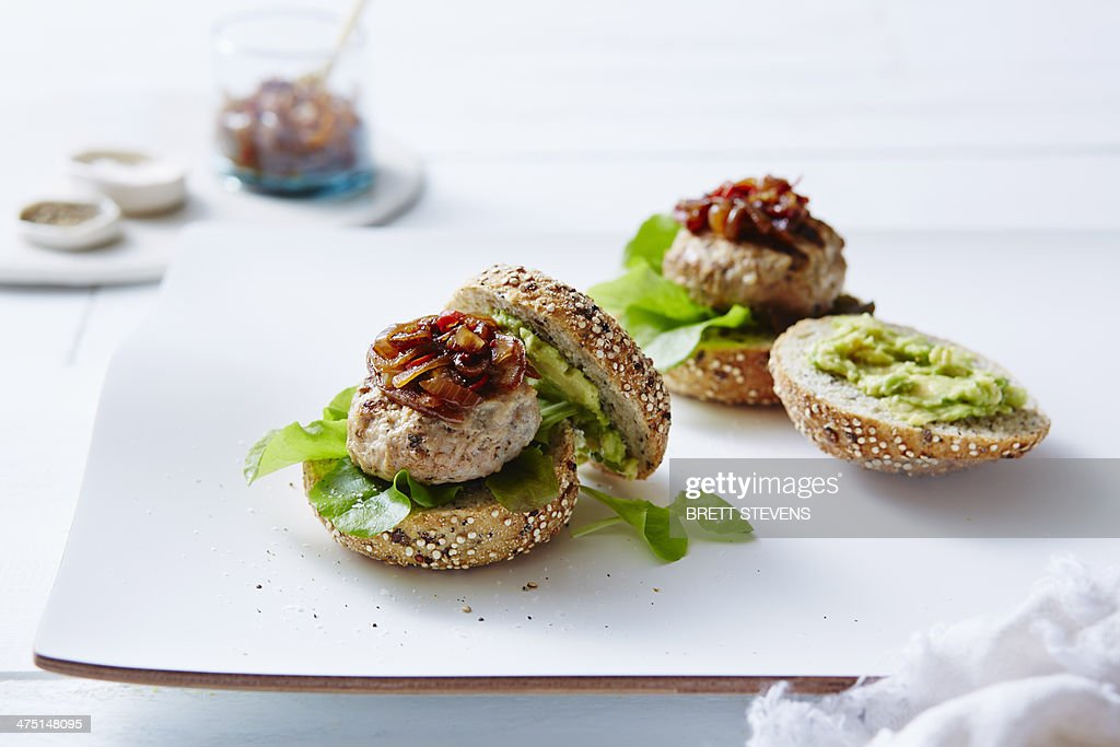 Still life of chicken and avocado burgers : Stock Photo
