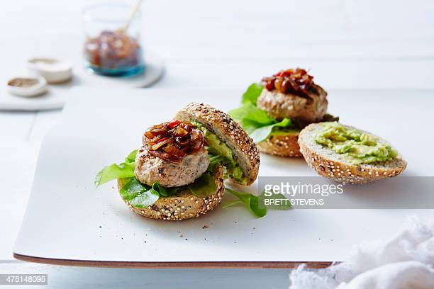 Still life of chicken and avocado burgers