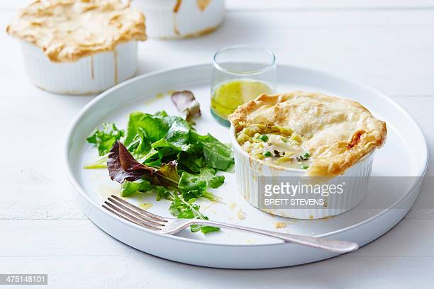 Still life of chicken, leek and pea pies