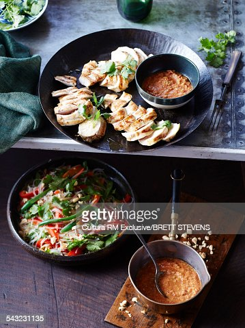 Still life of chicken with peanut sauce and salad