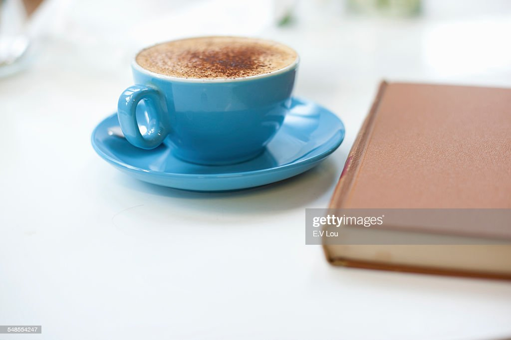 Still life of cup of coffee and book : Stock-Foto