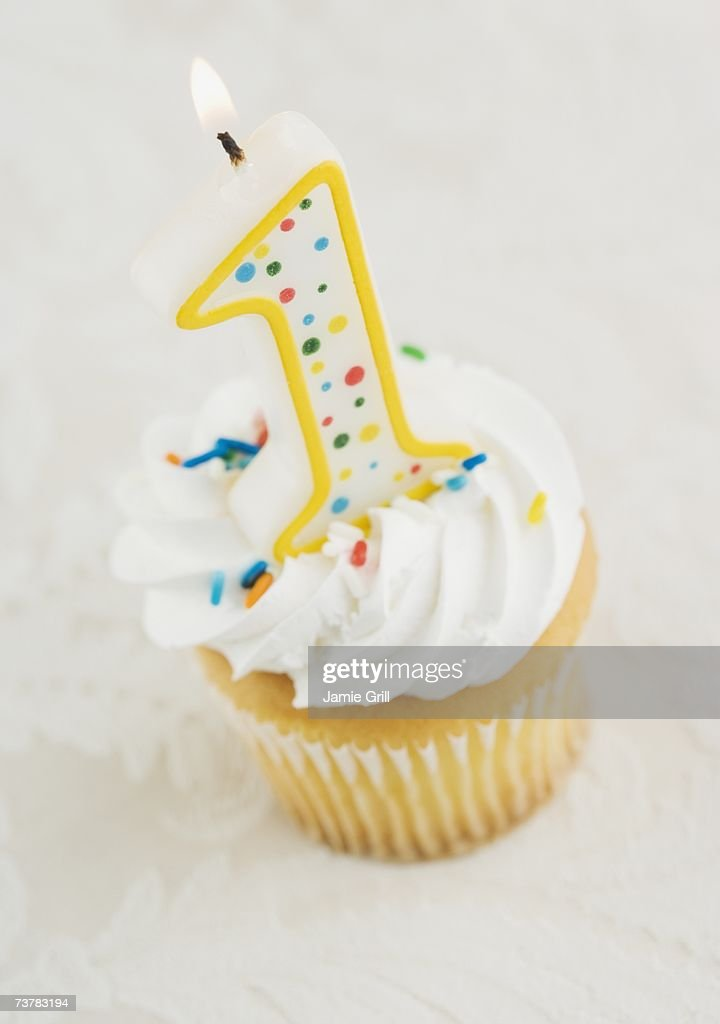 Still life of cupcake with one candle : Stock Photo