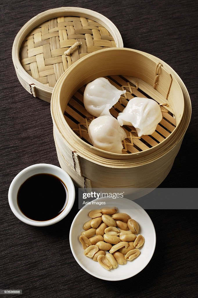 still life of dim sum with bamboo steamer : Stock Photo